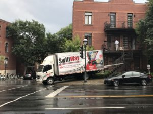 SwiftWay moving truck blocking the sidewalk