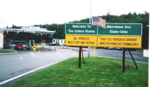 Sign posts at a border crossing between Canada and the United States