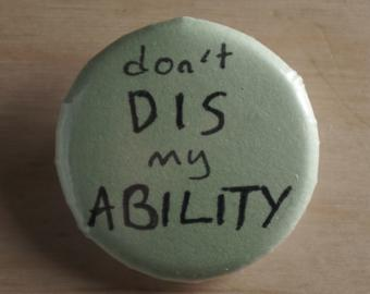 Button with hand written text Don't dis my ability.